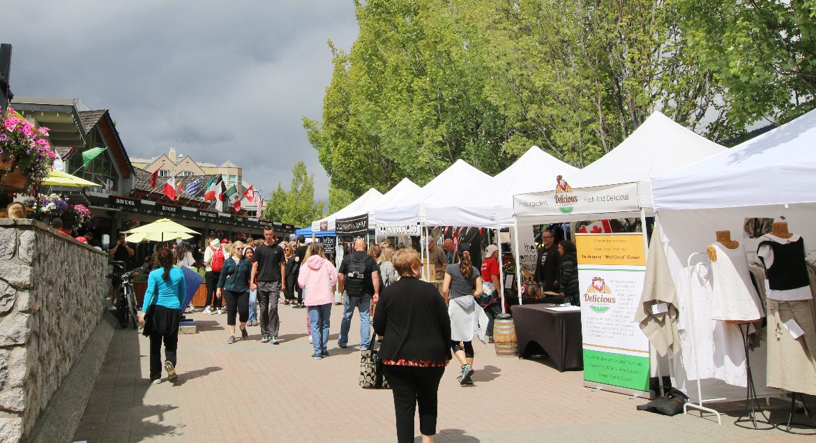 Market Vendors and Shoppers in Whistler